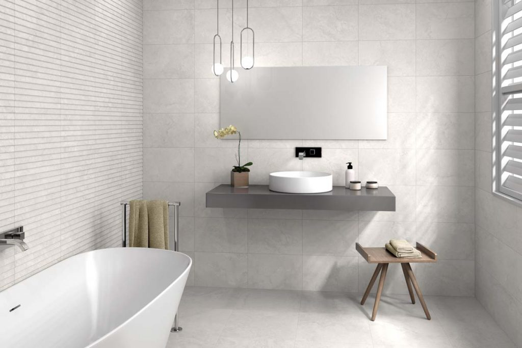 Bathroom white tiles with bath and sink.