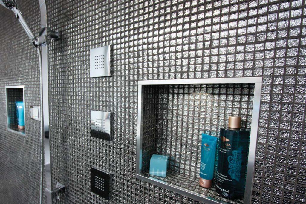 Bathroom glass mosaics with shower.