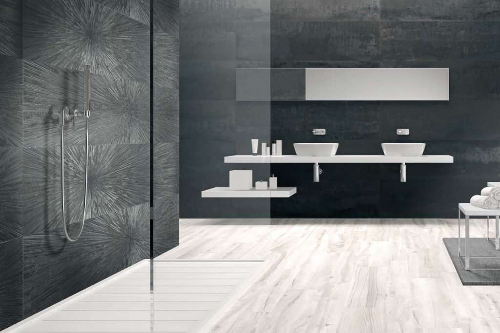 Bathroom steel effect tiles with sink.