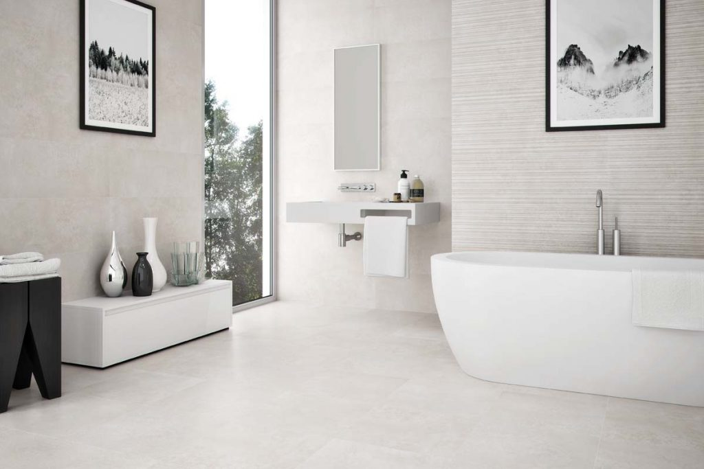 Bathroom stone effect tiles with sink.