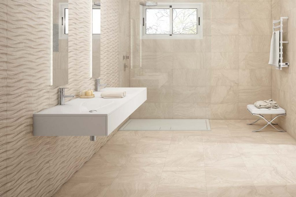 Bathroom stone effect tiles with sink and decor tile.