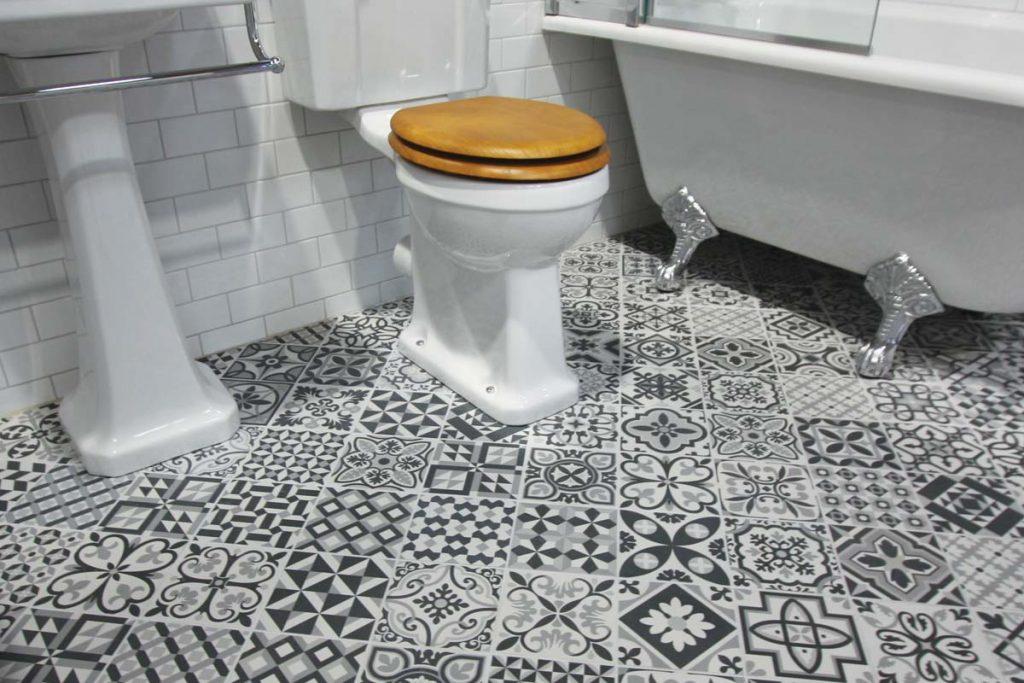 Bathroom black & white taco tiles with bath and toilet.
