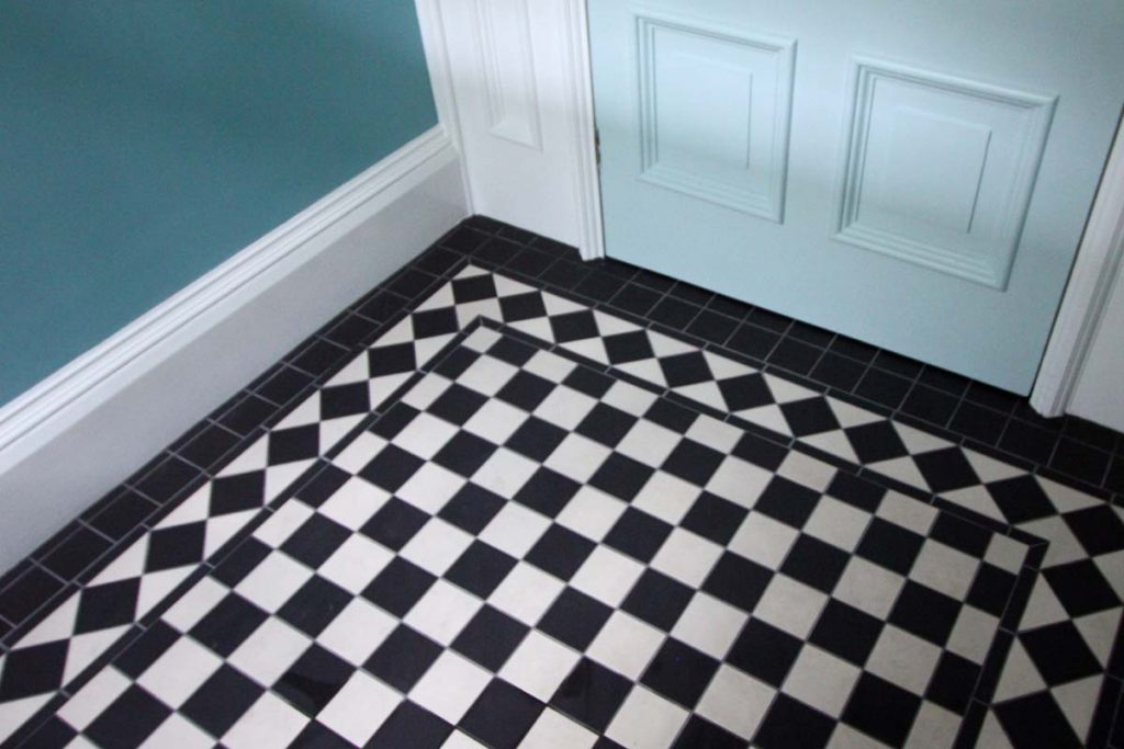 Hallway black and white chequered tiles.