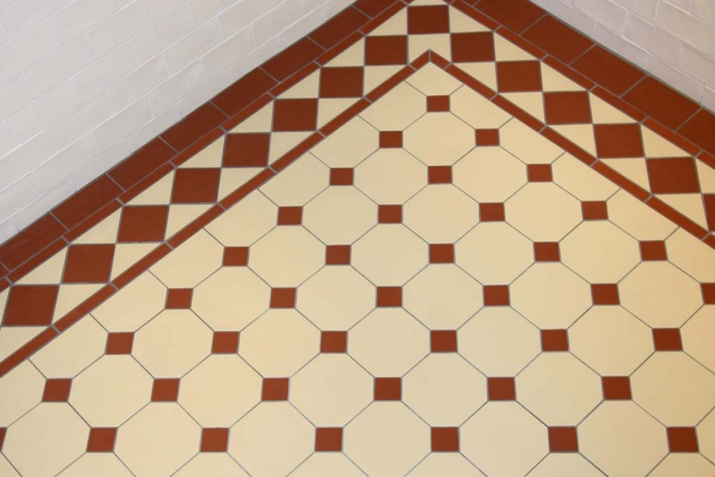 Hallway brown and cream chequered tiles.
