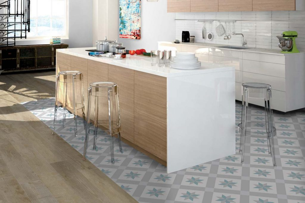 Kitchen blue, white and grey patterned floor tiles.