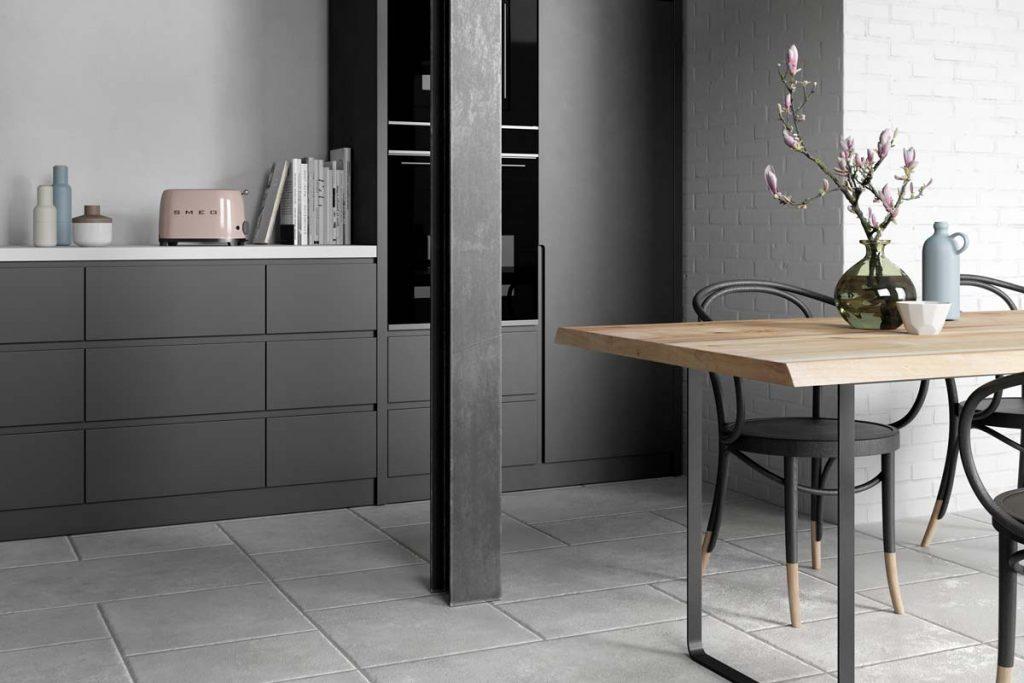 Kitchen dark grey stone effect tiles.
