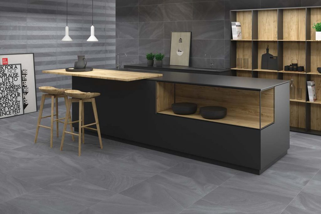 Kitchen dark grey stone effect tiles.