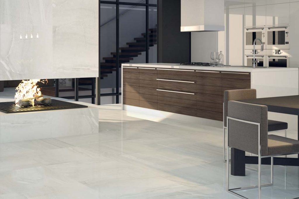 Kitchen cream marble effect floor tiles.