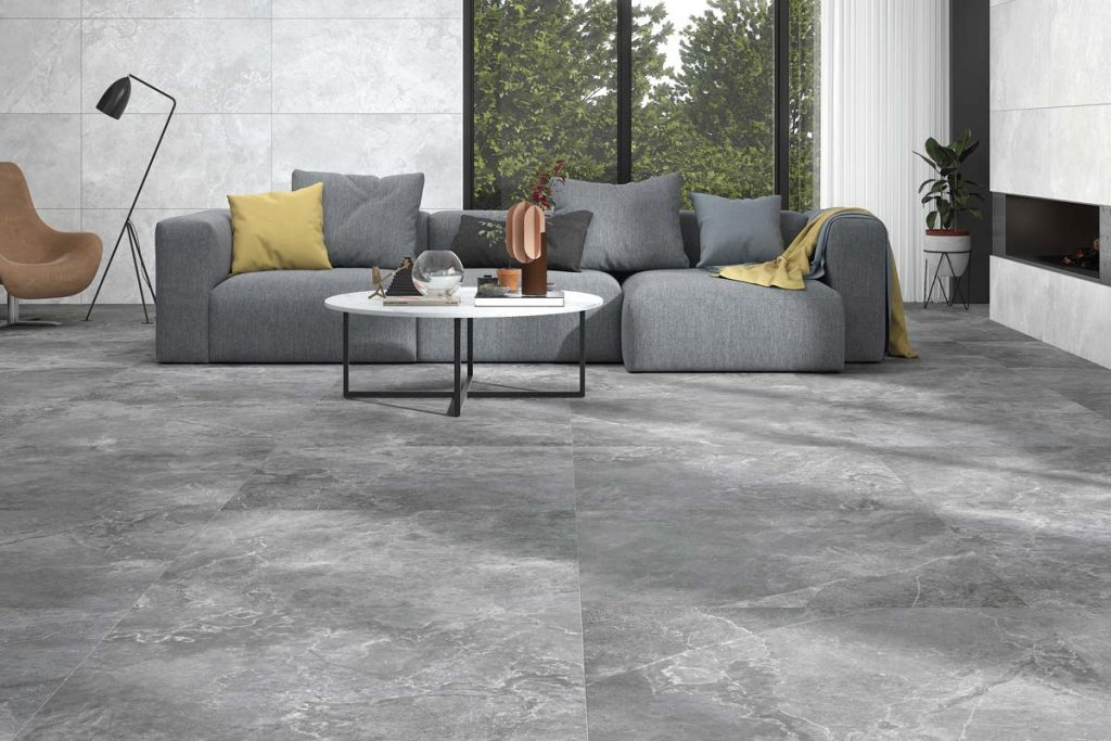 Living room dark grey stone effect tiles.