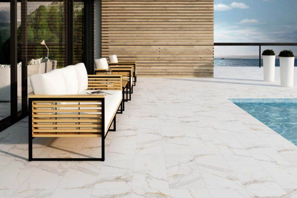 Marble effect floor tiles outside near swimming pool.