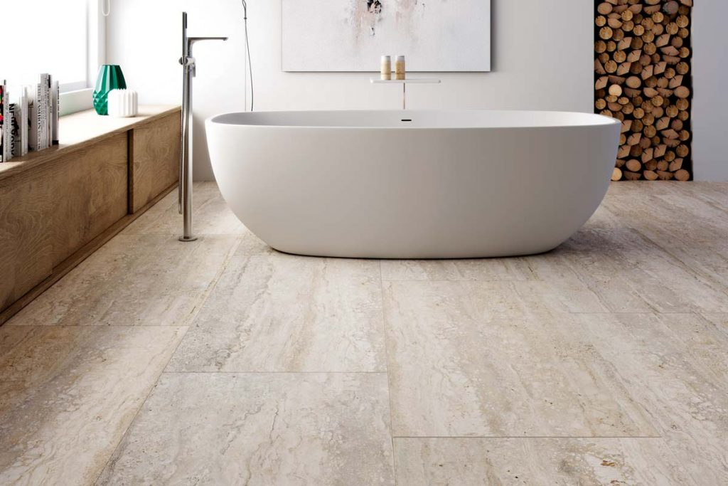 Marble effect beige floor tiles in bathroom.