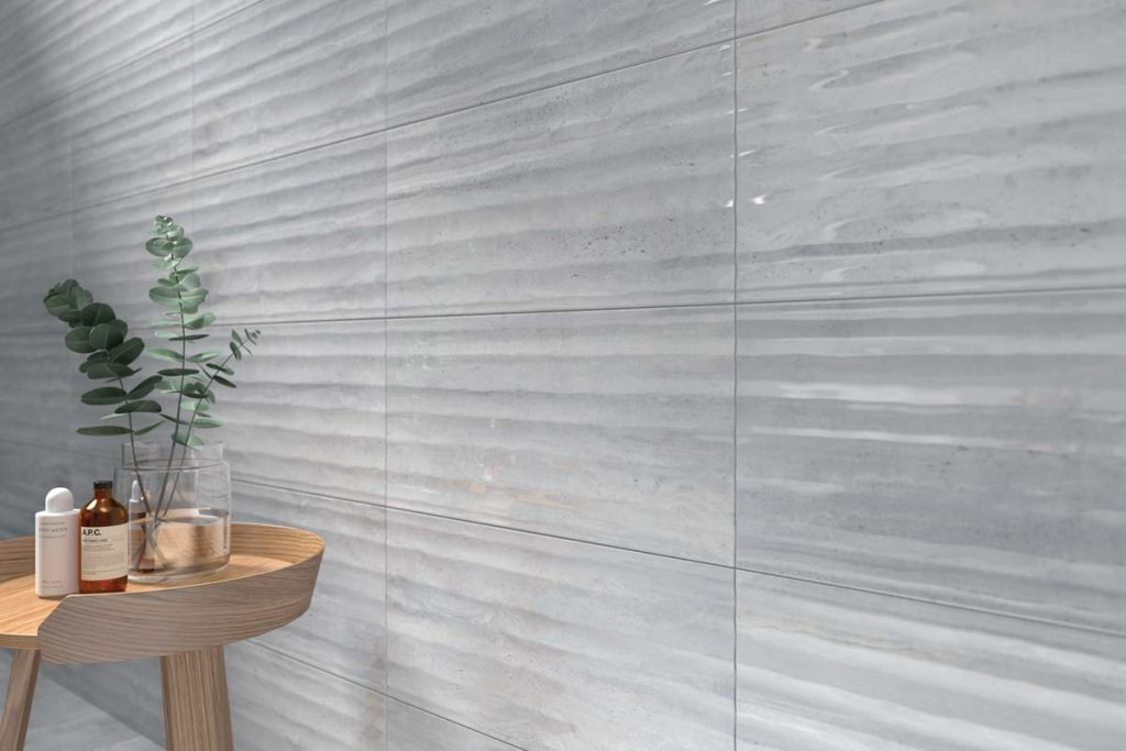 Marble effect grey decor wall tiles in kitchen.