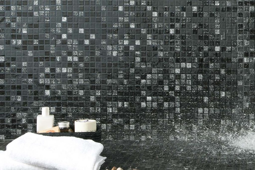 Mosaic square glass black tiles with a pearlescent facade.
