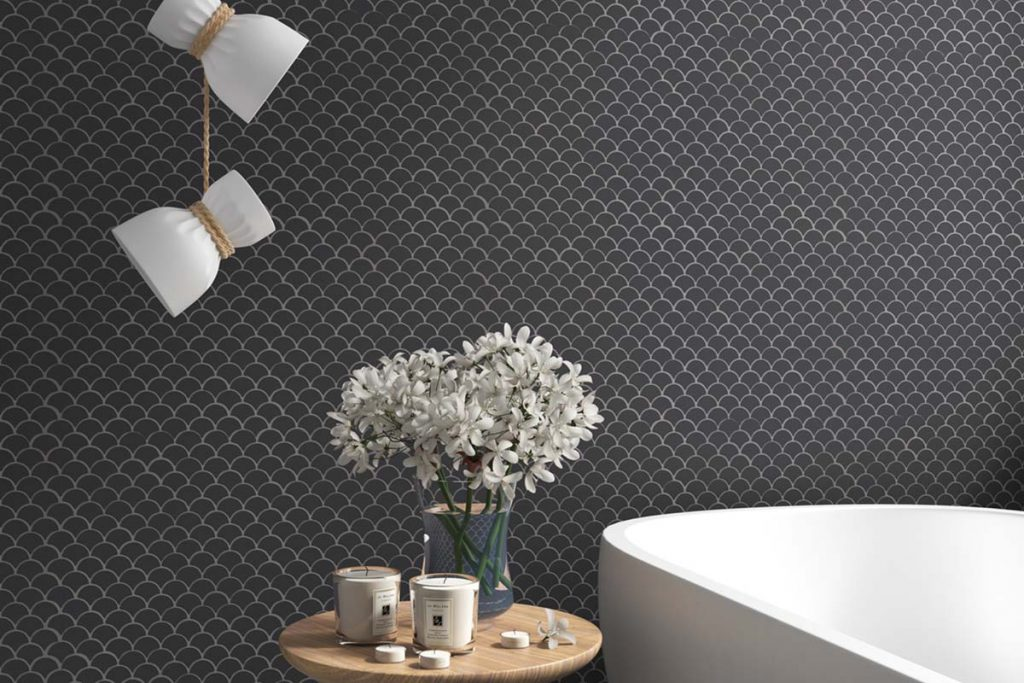 Mosaic fan inspired designed black glass tiles, shown here in a bathroom.