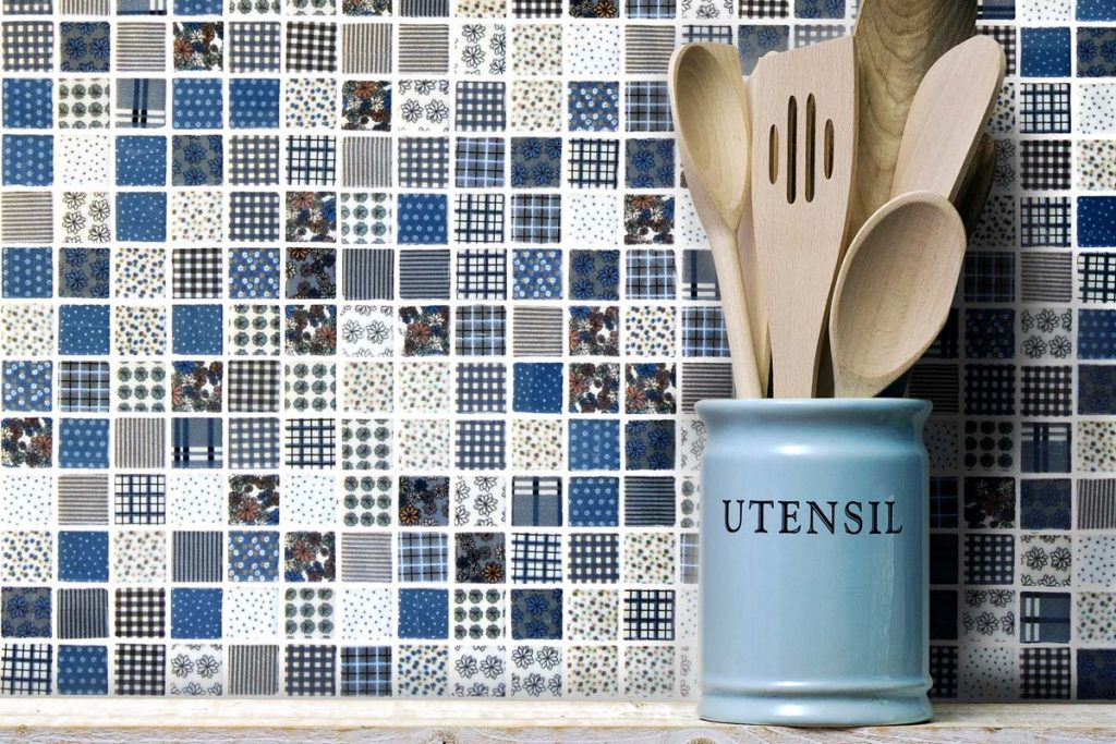 Mosaic square glass tiles with a random pattern, shown here in a kitchen close-up.