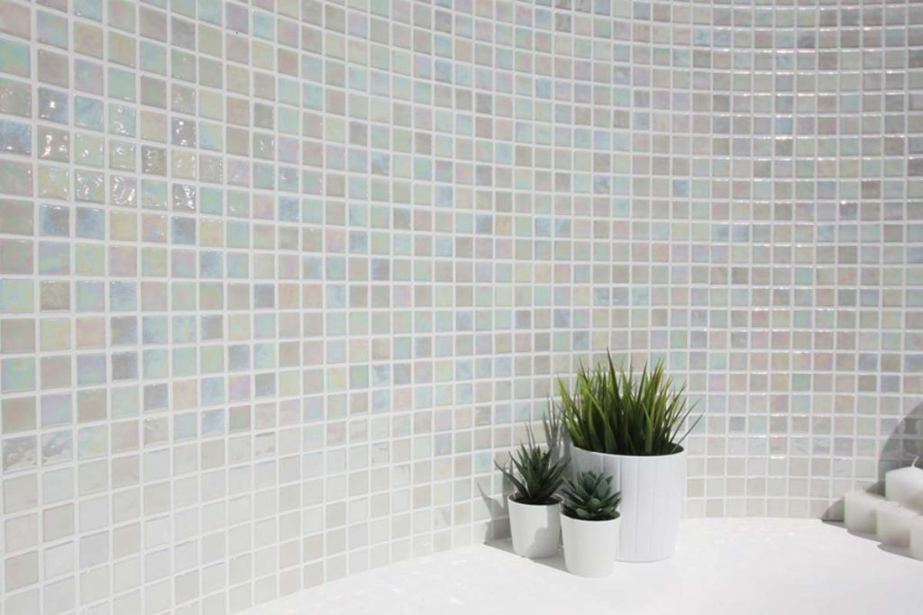 Mosaic square glass tiles in pastel colours shown here in a bathroom.