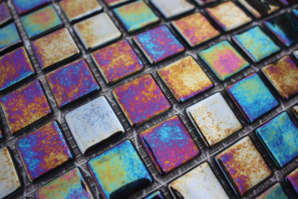 Mosaic square glass tiles in vibrant colours shown here in a close-up.