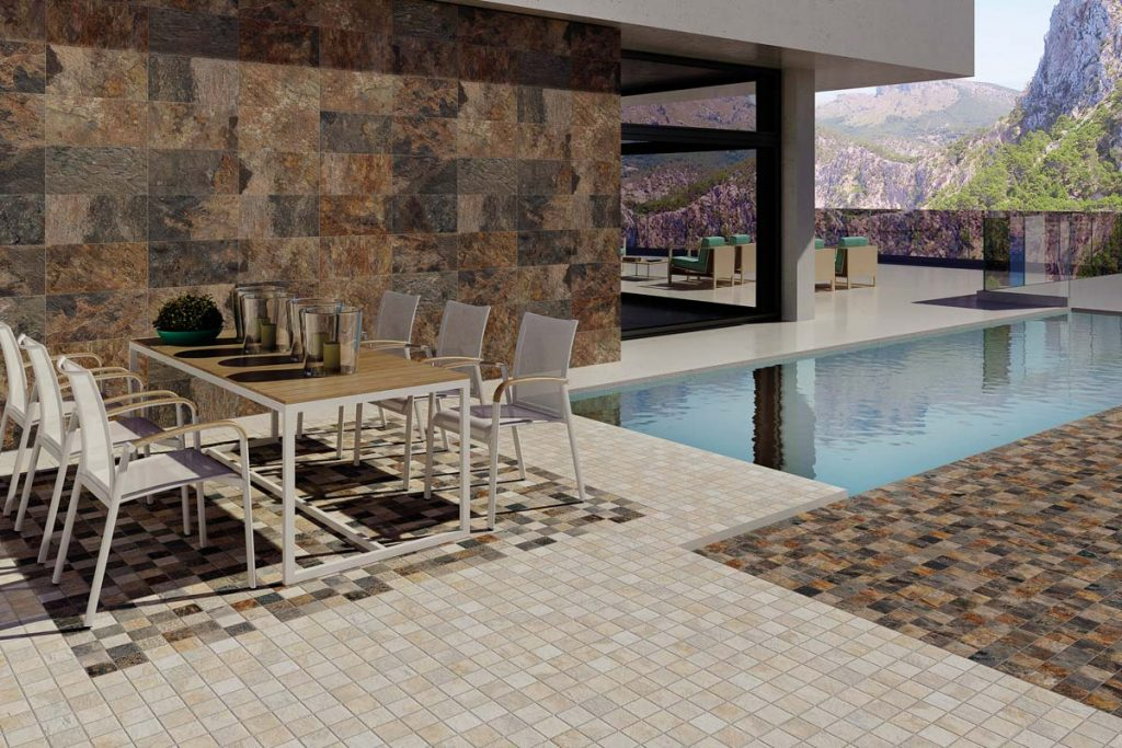 Outdoor stone effect tiles near swimming pool.