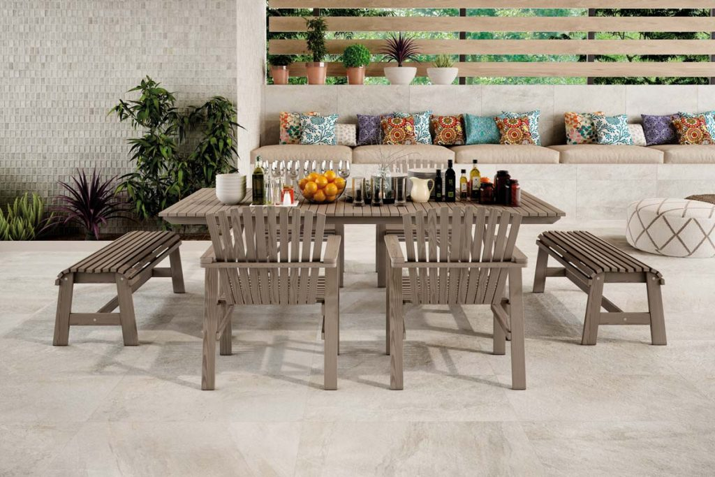 Outdoor stone effect tiles with outdoor table.