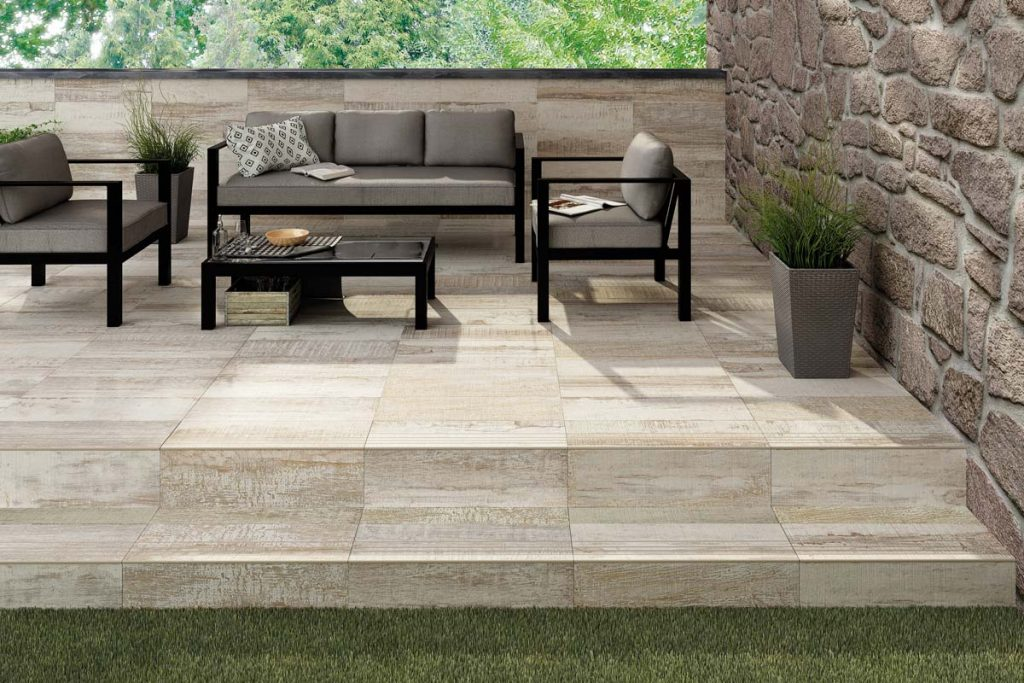 Outdoor wood effect tiles with outdoor seating.