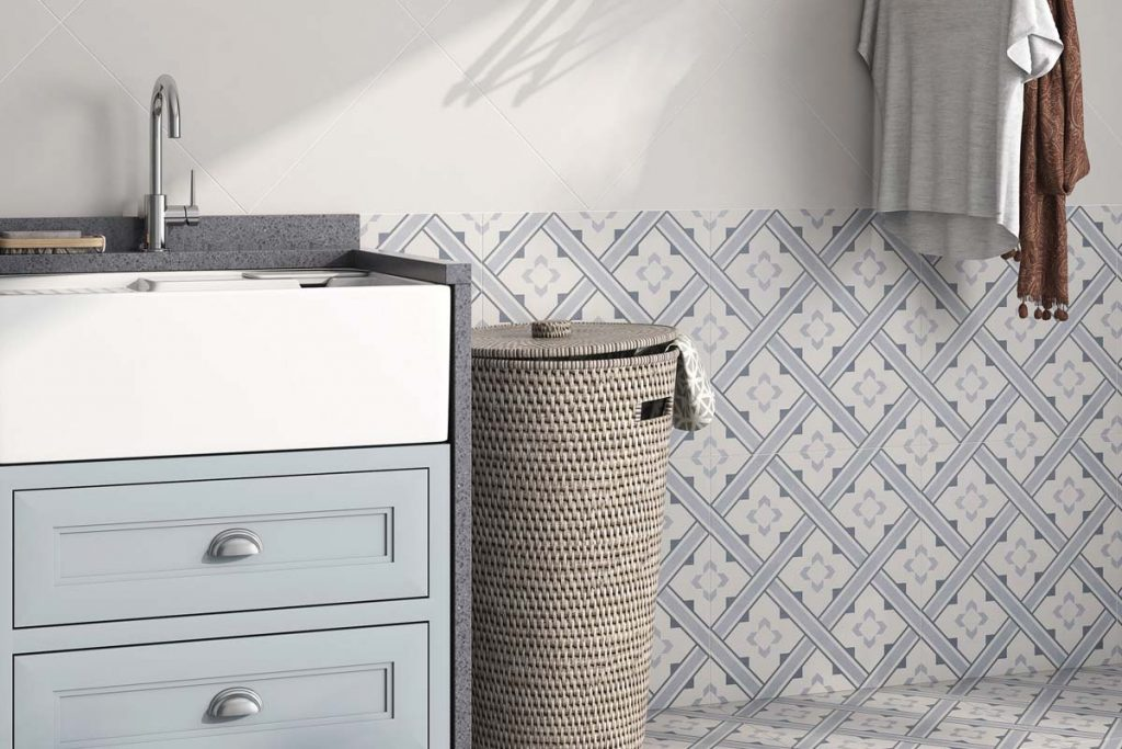 Glazed Porcelain pattern tiles. Pale blue and cream pattern, displayed here in a bathroom.
