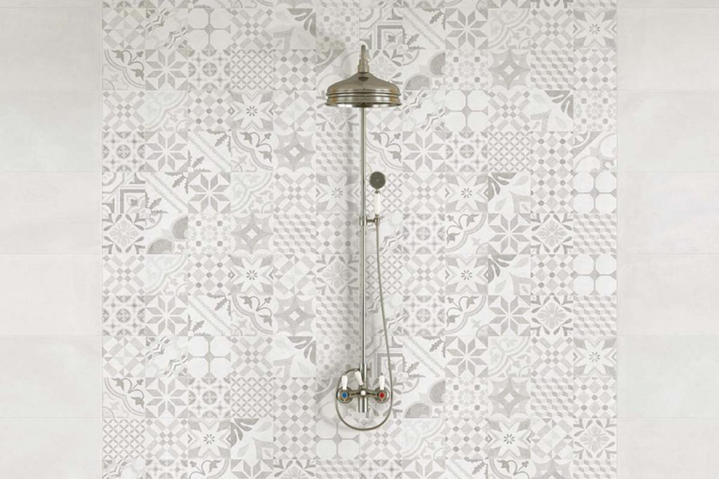 Glazed Ceramic tiles. Stunning pattern decor tiles in grey shades, which can be used alone or along side plain tiles to create an eye catching design. Displayed here in a shower.
