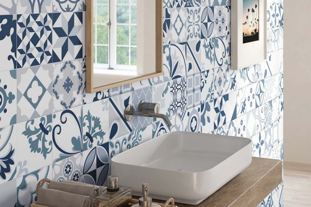 Glazed Porcelain tiles. Stunning pattern tiles in bold shades of blue. Displayed here in a bathroom.