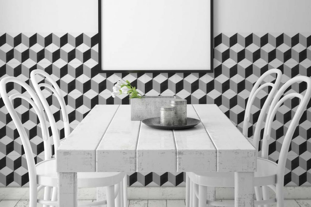 Glazed Porcelain tiles. Stunning pattern tiles in black & white shades which can be used alone or along side plain tiles to create an eye catching design. Displayed here in a restaurant.