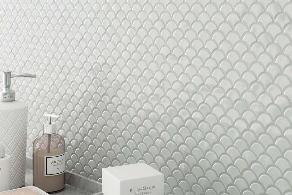 Glass mosaics in a fan shape. White colour with a gloss finish, displayed here in a bathroom.