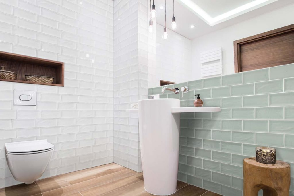 Glazed ceramic rectangular tiles. Pastel green accompanied by plain white. Displayed here in a bathroom.