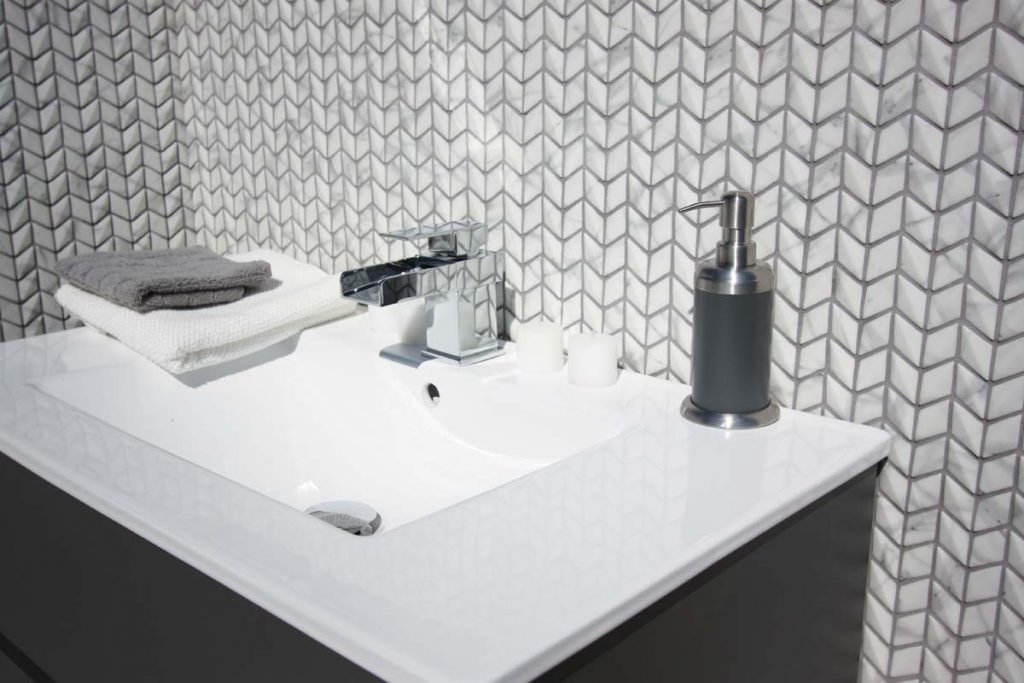 Glass marble effect mosaics in a diamond shape. Soft matt and unpolished finish. Displayed here in a bathroom.