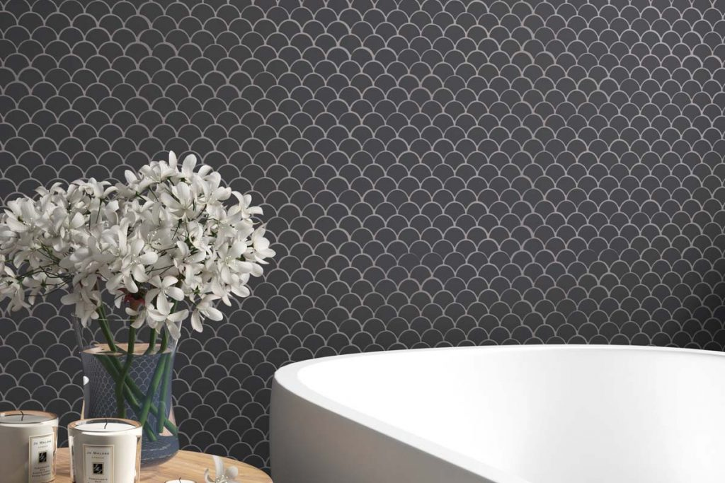 Glass mosaics in a fan shape. Black colour with a matt finish, displayed here in a bathroom.
