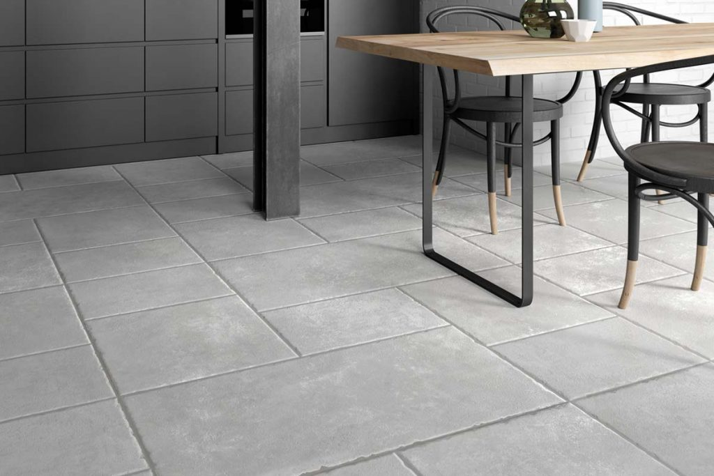Glazed Porcelain grey stone effect tiles. Displayed here on a kitchen floor.