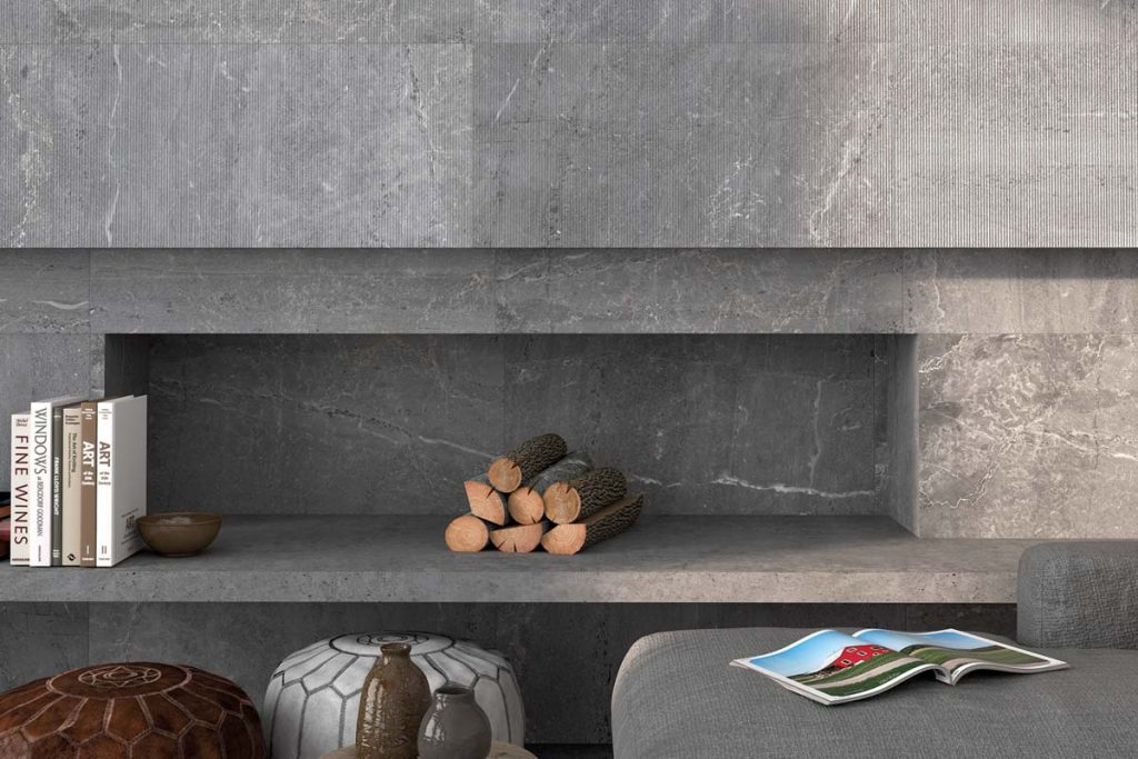 Dark grey Glazed Porcelain stone effect tiles. Displayed here in a living room with matching decor.