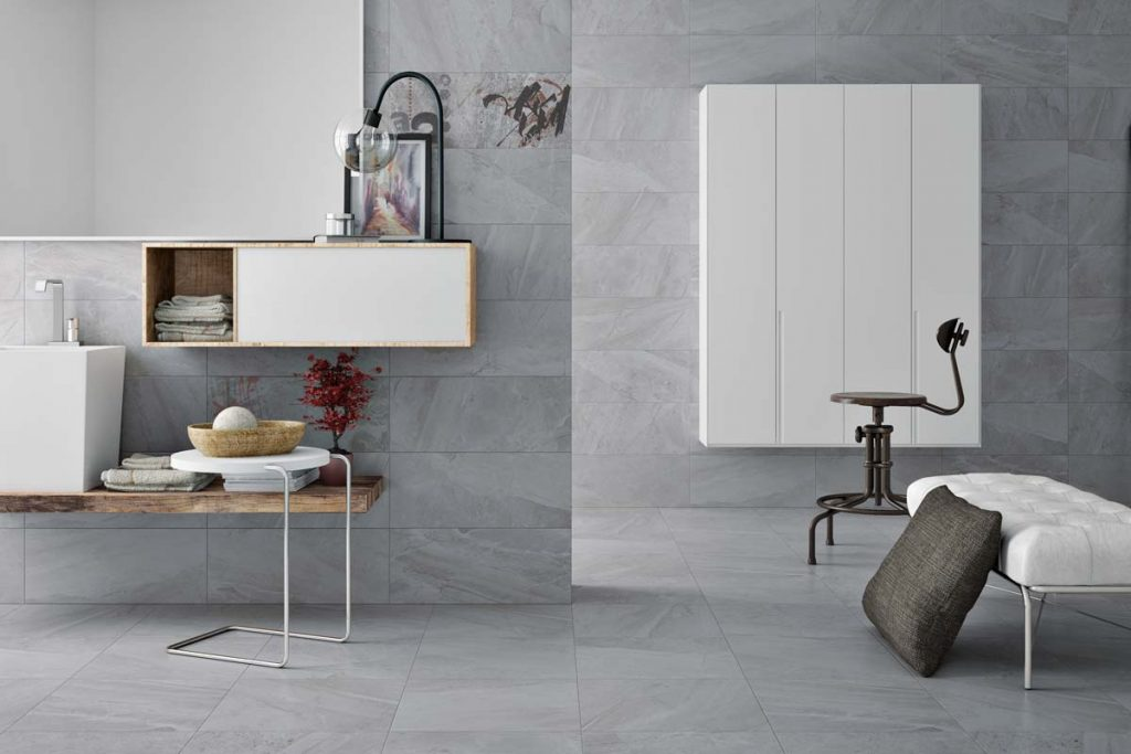 Glazed Ceramic stone effect tiles in a light grey shade. Displayed here in a bathroom.