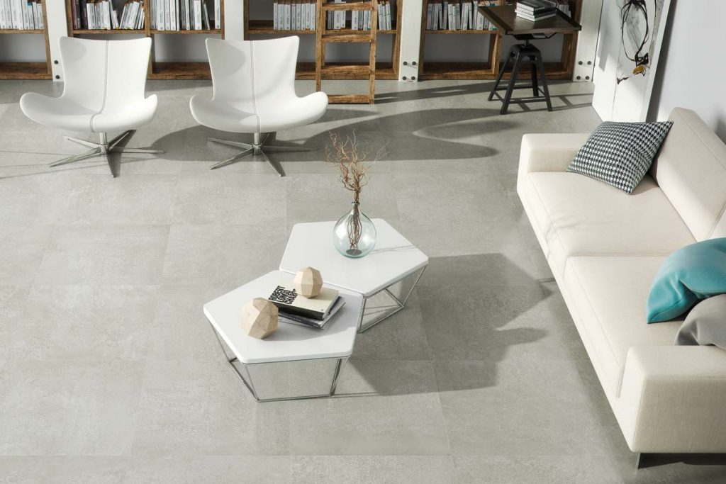 Glazed Porcelain concrete effect tiles, beige with a matt finish. Displayed here in a living room.