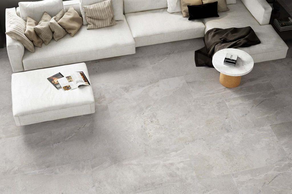 Glazed Porcelain grey stone effect tiles. Displayed here on a living room floor.