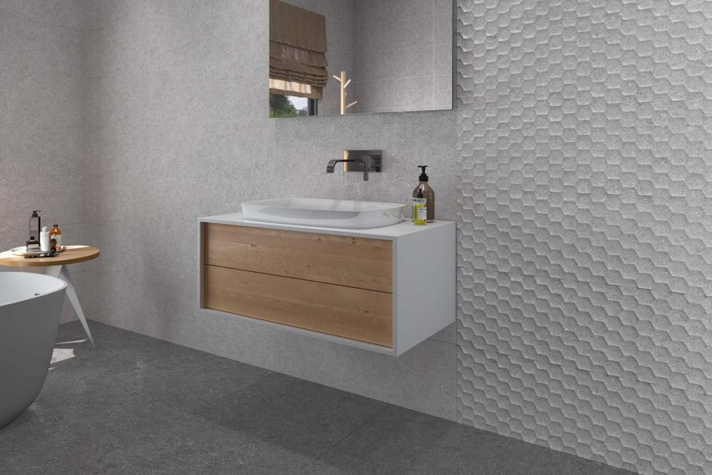 Glazed Ceramic wall and Glazed Porcelain floor stone effect tiles in grey. Displayed here in a bathroom with matching decor.