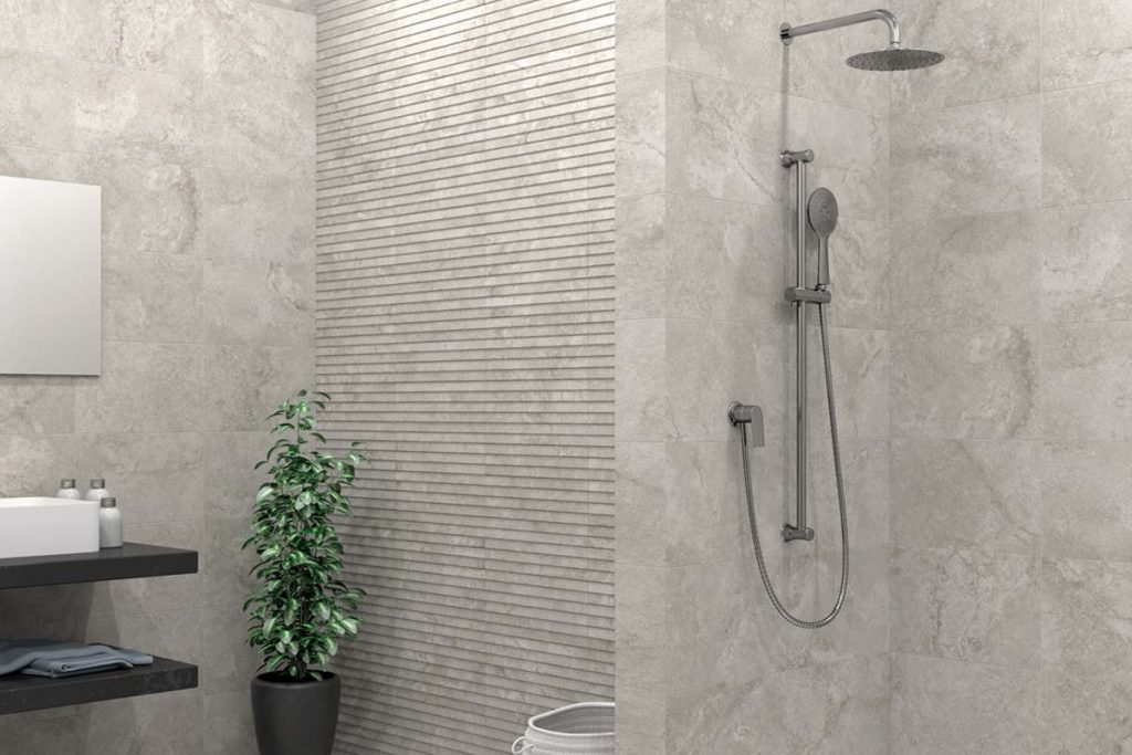 Glazed Ceramic stone effect tiles in cream. Displayed here in a bathroom with matching decor.
