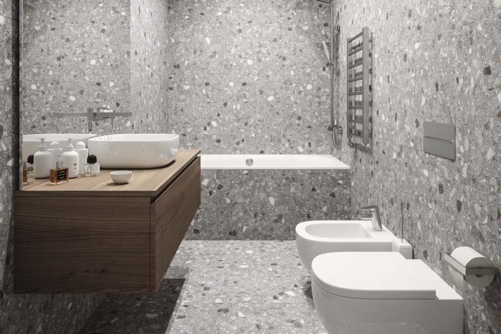 Glazed Porcelain grey terrazzo stone effect tiles with a natural finish. Displayed here in a bathroom.