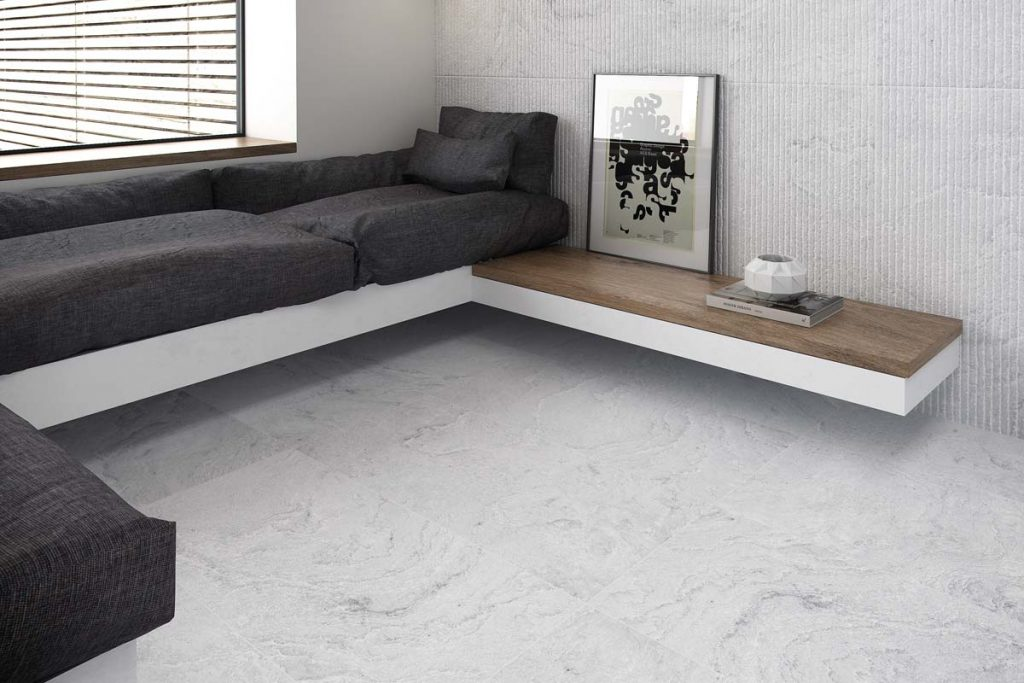 Glazed Porcelain floor stone effect tiles in grey. Displayed here in a living room with matching decor.