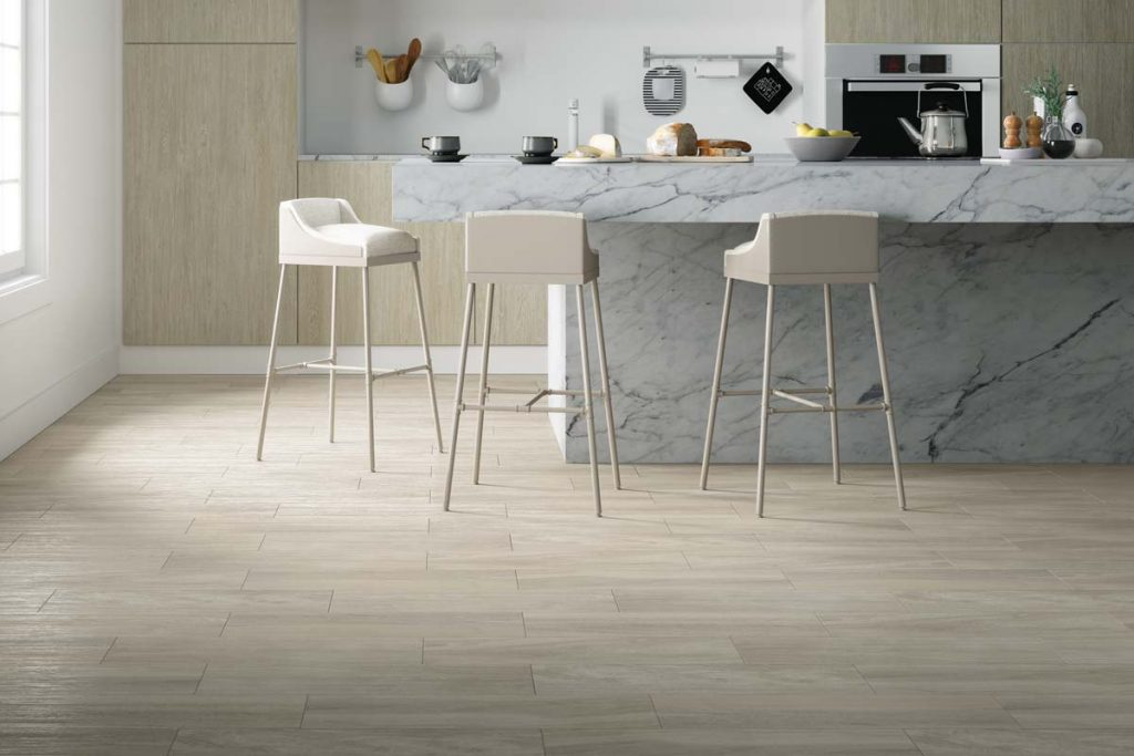 Glazed Ceramic wood effect tiles in a light beige. Displayed in a kitchen.