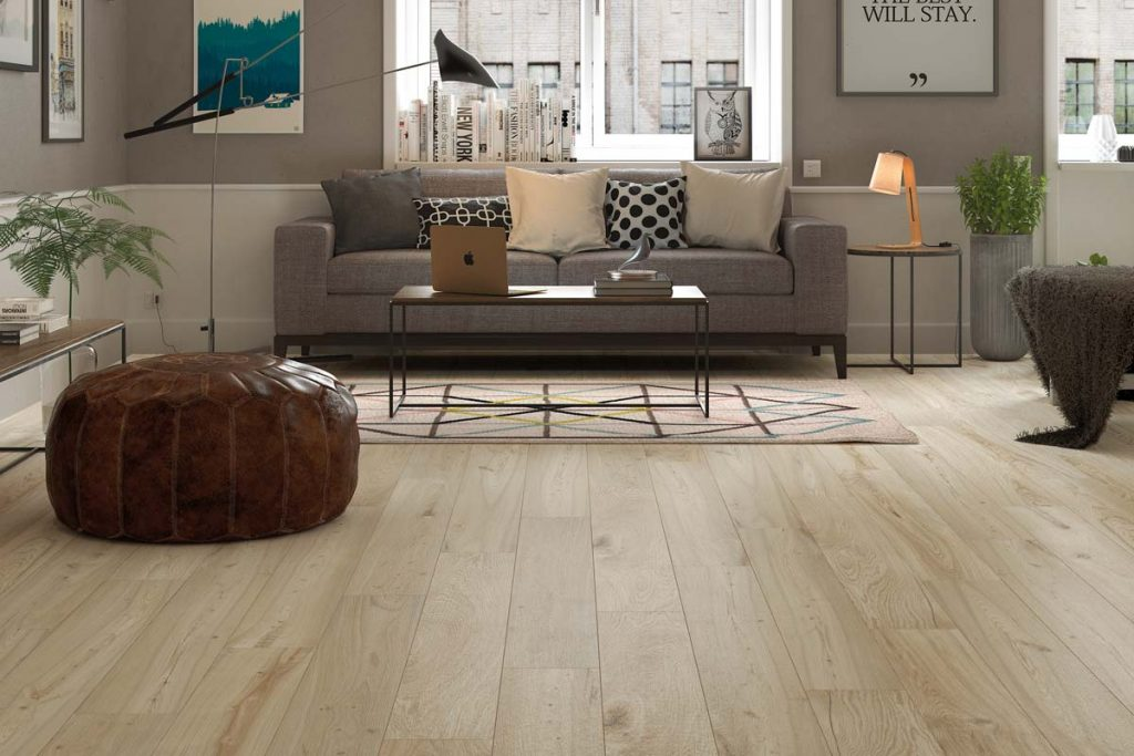 Glazed Porcelain wood effect tiles in a light brown. Displayed in a living room.