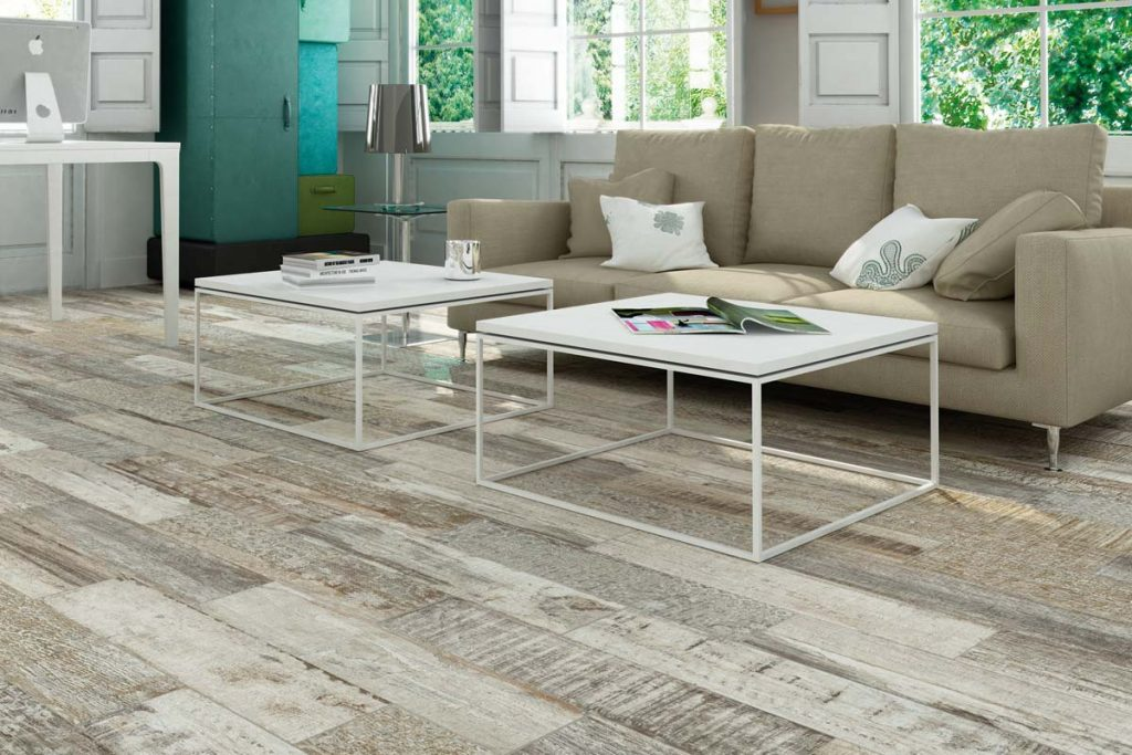 Glazed Porcelain wood effect tiles in a variety of brown shades. Displayed in a living room.
