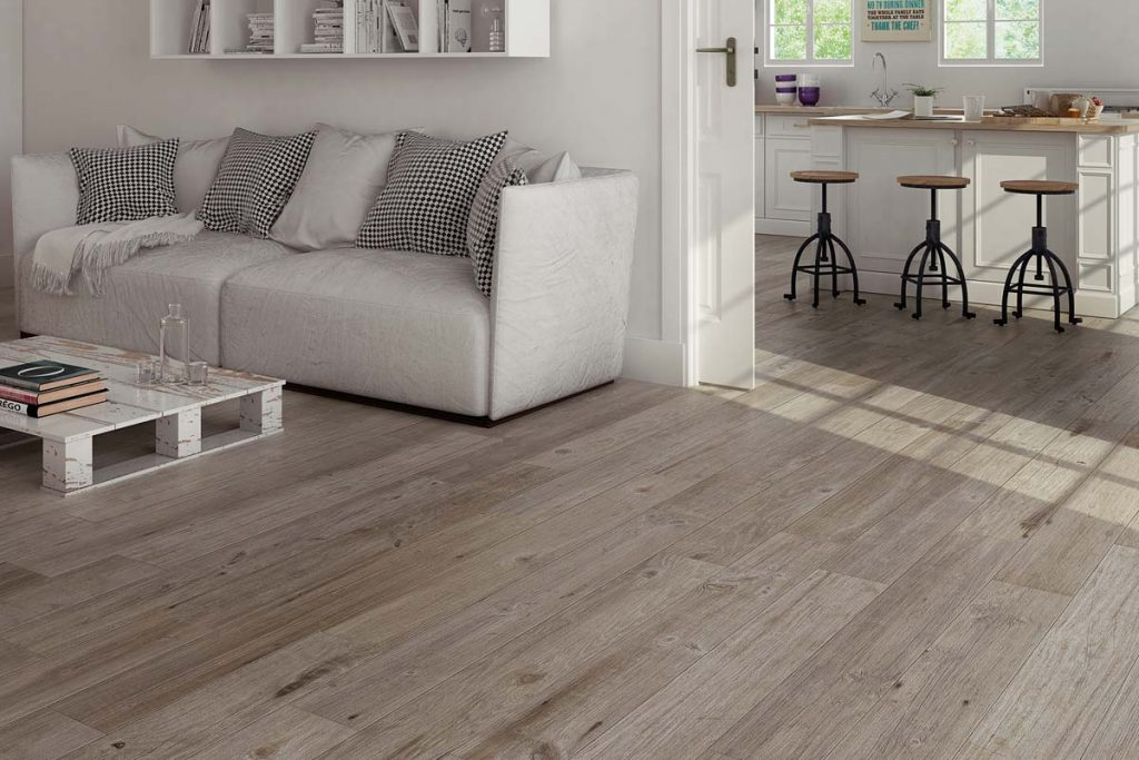 Glazed Porcelain wood effect tiles in light brown shades. Displayed in a living room.